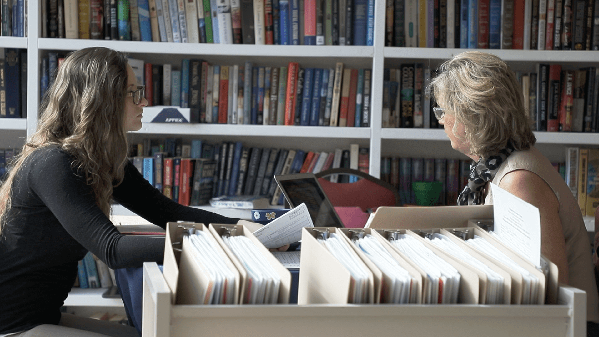 Two women in a library